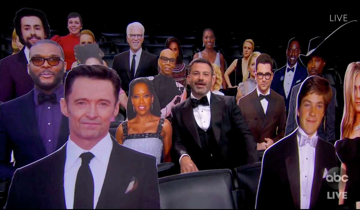 Host Jimmy Kimmel poses with a gaggle of celebrity cardboard cutouts during the 72nd Annual Emmy Awards on Sunday evening.