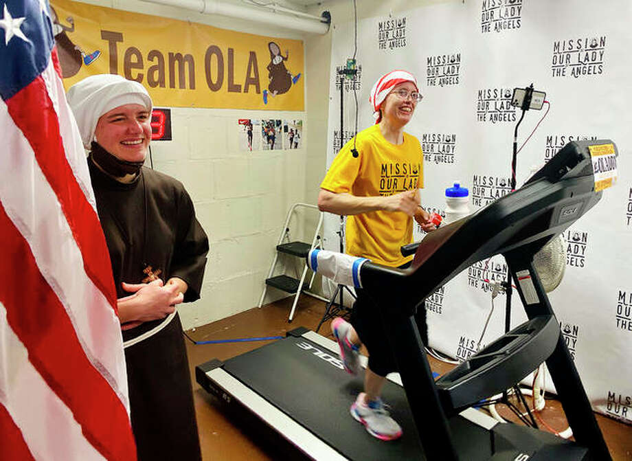 Sister Stephanie Baliga runs a marathon on a treadmill in the basement of Mission of Our Lady of the Angels church in Chicago. When the Chicago Marathon was canceled this year because of the coronavirus pandemic, Baliga and her fellow nuns live-streamed the run and raised money for their community. Photo: P. Weiland | AP