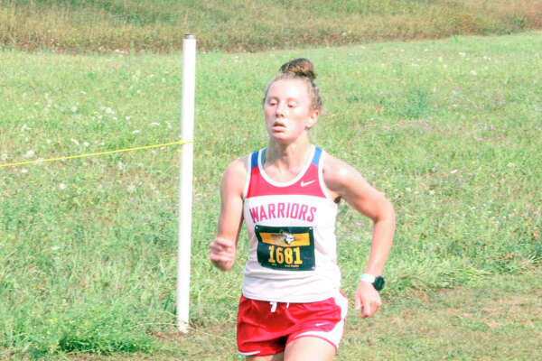 Sarah Storey nears the end of a home race for Chippewa Hills earlier this season.