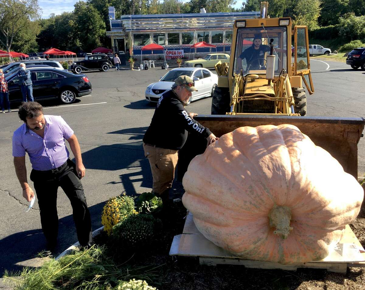 George Marnelakis (left), owner of the Blue Colony Diner in Newtown, said he places a giant pumpkin out front every year and almost didn't do it this year.