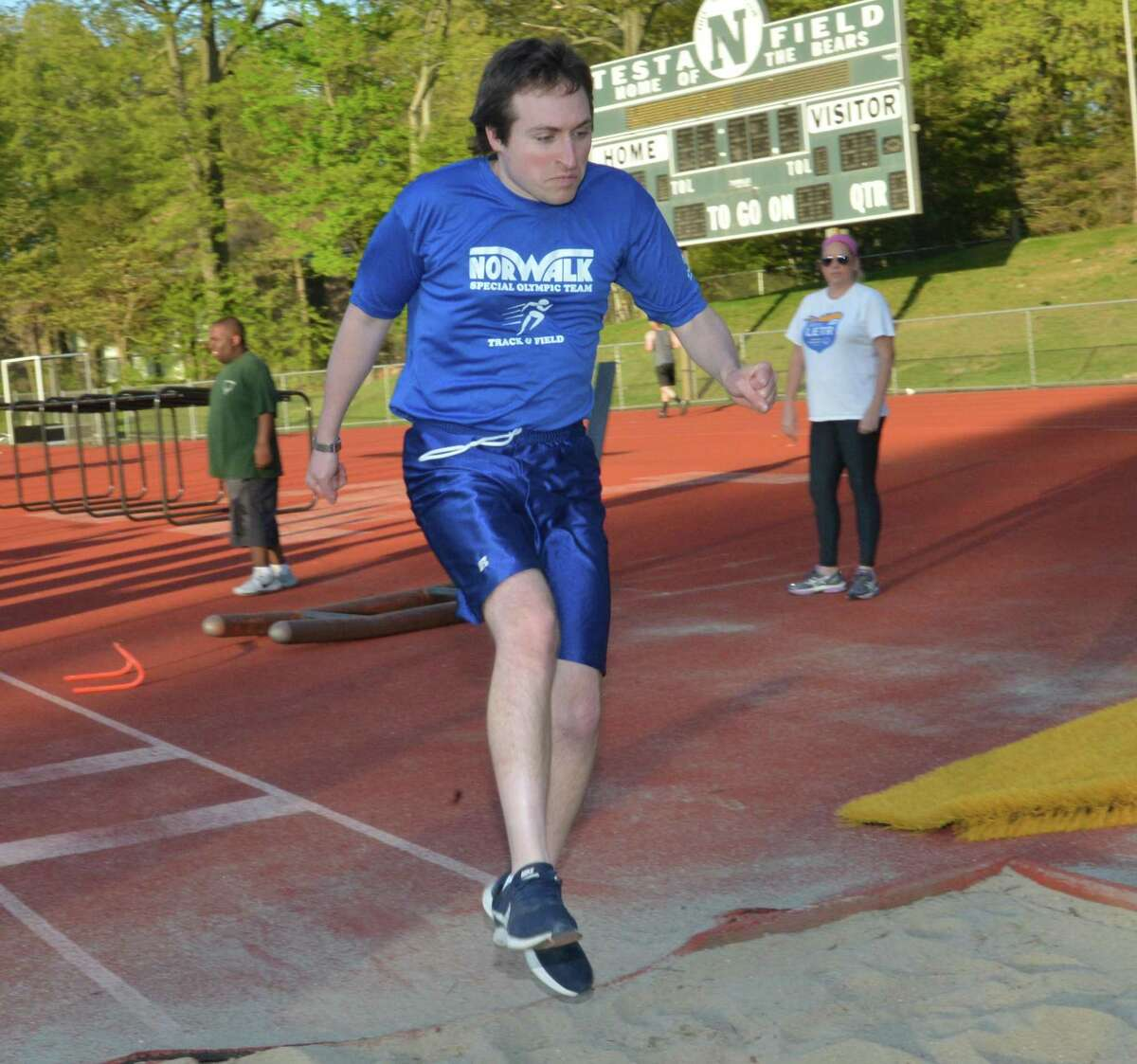 Alan Holomakoff takes a turn at the long jump while training with the Norwalk Special Olympics team at Norwalk high on Wednesday May 9, 2018 in Norwalk Conn.