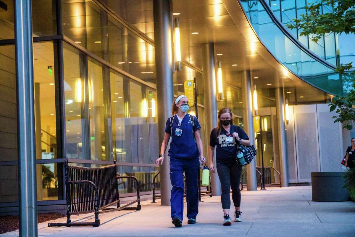 Nurse Kelly Williams, left, and friend and co-worker, Emma Cranston, exit The Johns Hopkins Hospital following Williams shift in the emergency department.