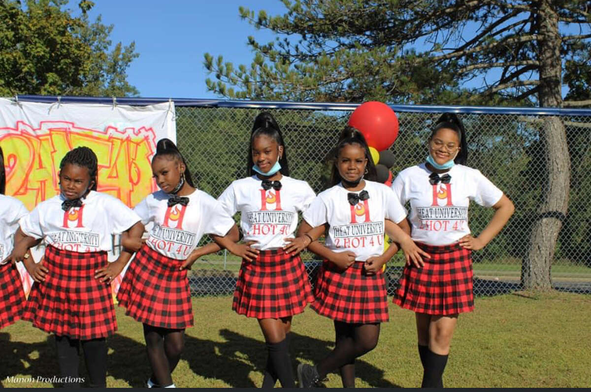 Members of the 2HOT4U Dance Team pose at a talent show held at the Arbor Hill Sports Complex on Saturday, Sept. 19, 2020.