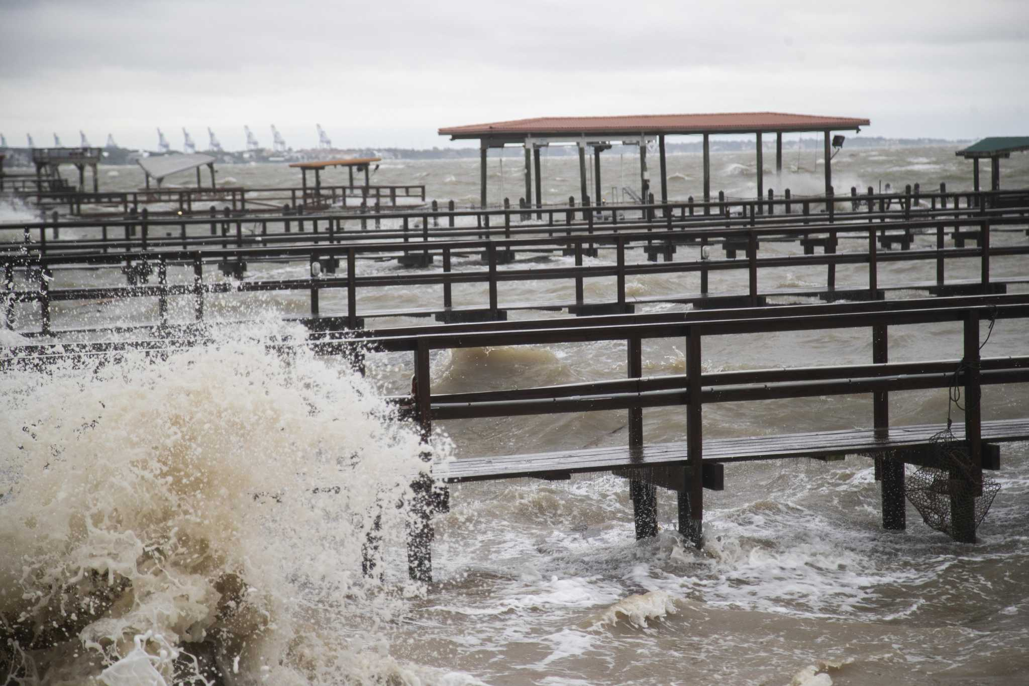 Part of Galveston's 61st Street Pier, a popular fishing spot, washed up on a nearby beach