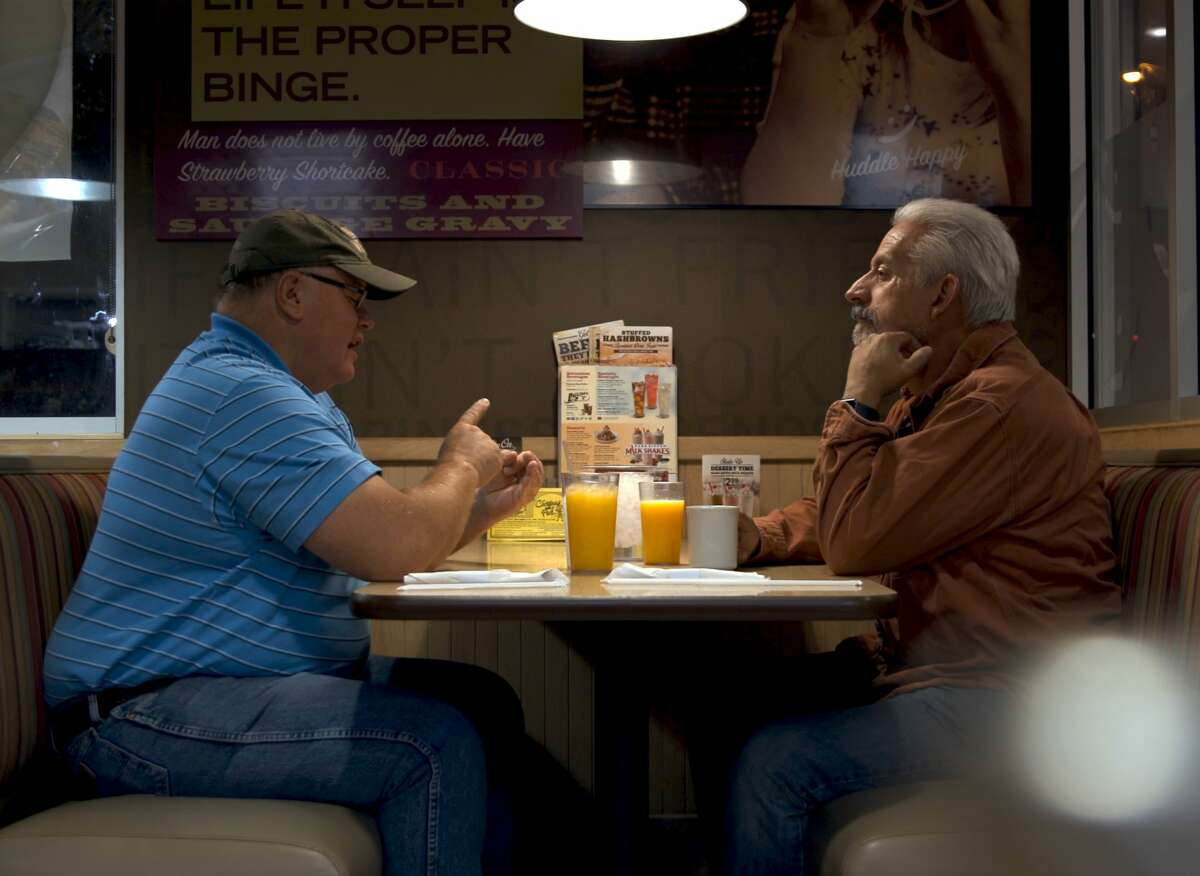 Rancher Gabe Brown and conservation agronomist Ray Archuleta discuss strategy over an early morning breakfast in