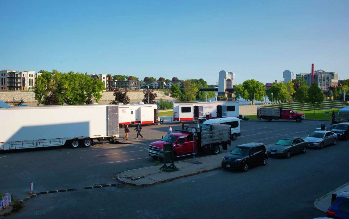 Trailers are seen in Riverfront Park as cast and crew members from the Amazon television show Modern Love, prepare to film scenes on Monday, Sept. 21, 2020, in Troy, N.Y. The show is filming in Troy for several days. (Paul Buckowski/Times Union)