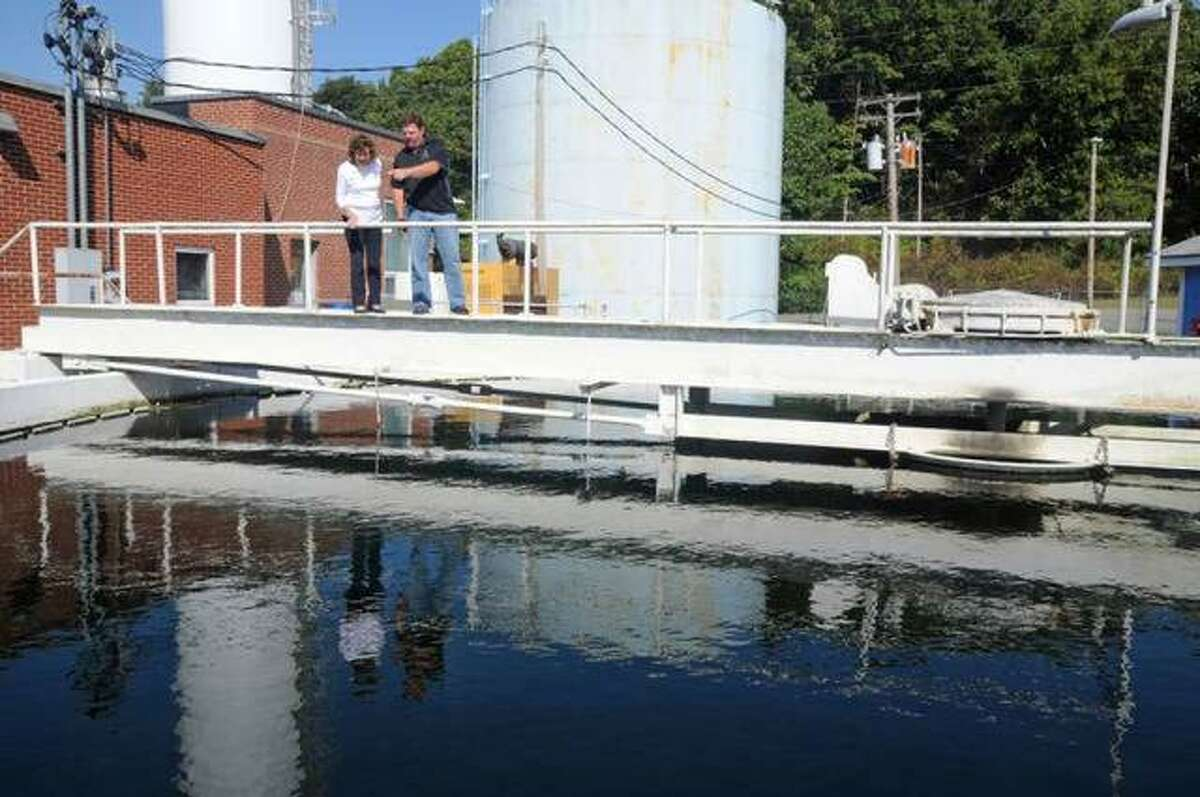 In this October 2018 photo, Carlinville Mayor Deanna Demuzio and Public Works Director Dan Held examine Carlinville's water plant.