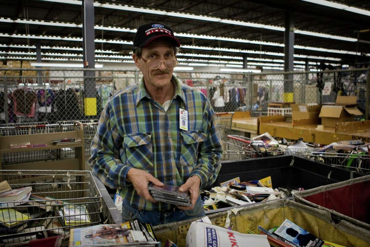 The Salvation Army Adult Rehabilitation Center, located on Washington Avenue in Houston, is a six-month work therapy program that helps men 21 to 65 years turn their lives around from drug and alcohol addiction. Here, a staff member at The Salvation Army Family Store sifts through items to be sold.