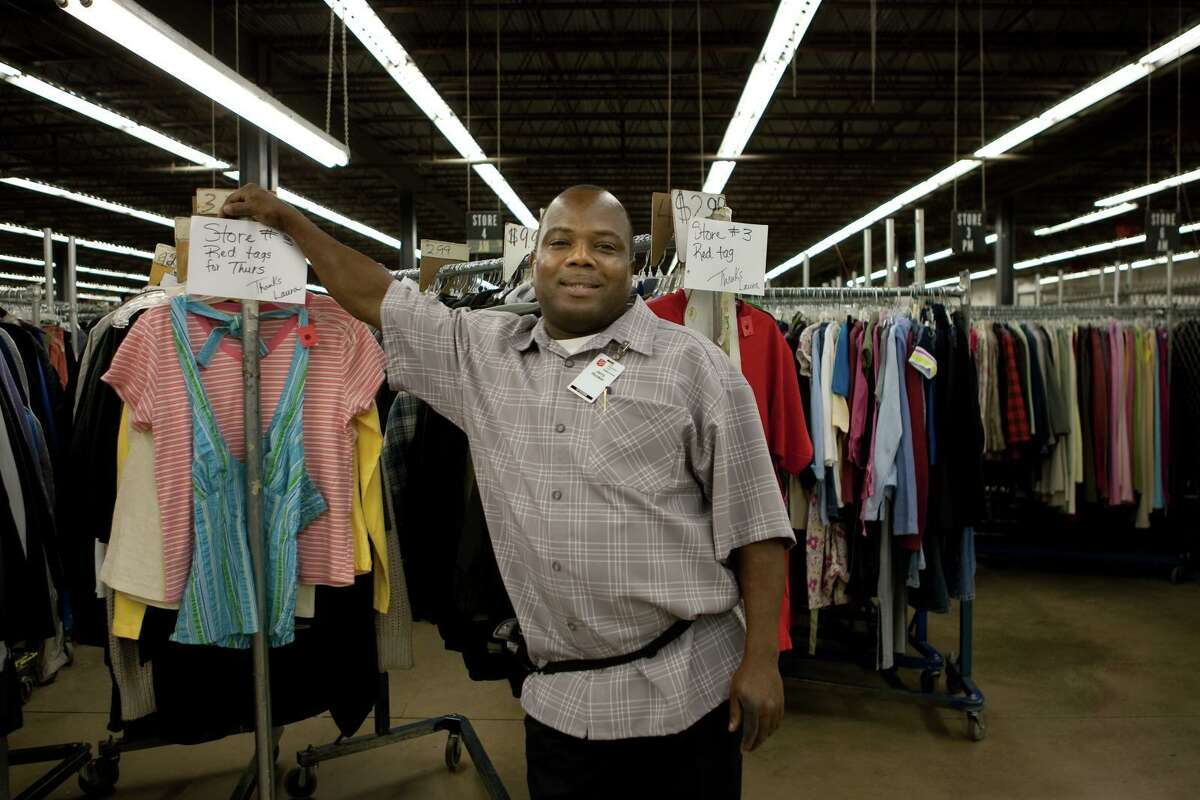 The Salvation Army Adult Rehabilitation Center in Houston is a work therapy program that assists men as they try to turn their lives around from drug and alcohol addiction. Here, a staff member at The Salvation Army Family Store poses.