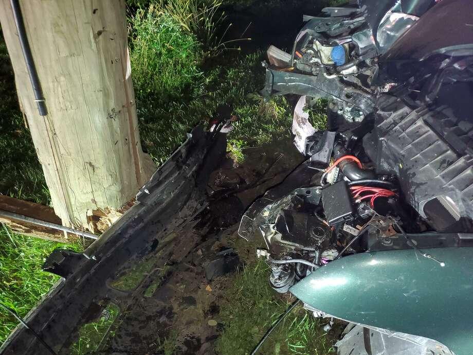 The scene of Friday night's car vs. utility pole crash on Gillotti Road in New Fairfield, Conn. Photo: New Fairfield Volunteer Fire Department