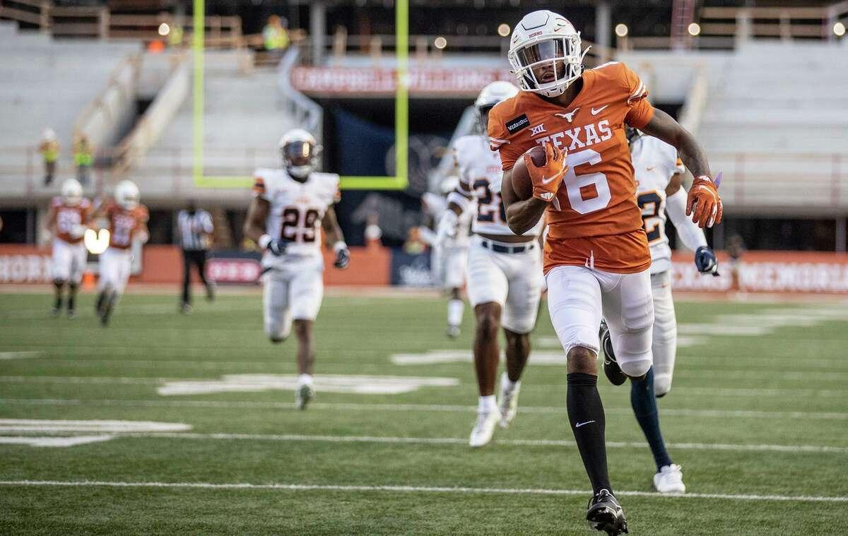 Texas' Joshua Moore (6) run into the end zone for a touchdown against UTEP during the first quarter of an NCAA college football game Austin, Texas, Saturday, Sept. 12, 2020. (Ricardo B. Brazziell/Austin American-Statesman via AP)