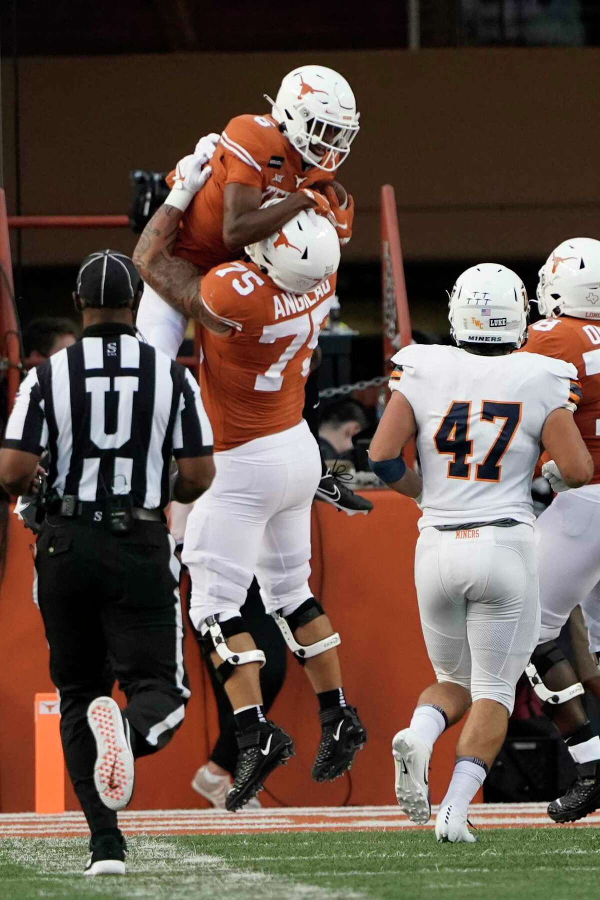 Texas' Joshua Moore (6) celebrates his touchdown catch against UTEP with Junior Angilau (75) during the first half of an NCAA college football game in Austin, Texas, Saturday, Sept. 12, 2020. (AP Photo/Chuck Burton)