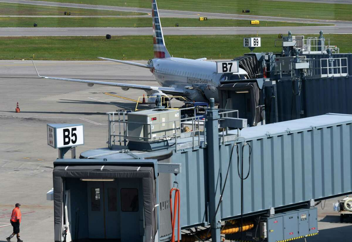 An American Airlines jet sits at a terminal at Albany International Airport on Monday, Sept. 21, 2020, in Colonie, N.Y. (Will Waldron/Times Union)