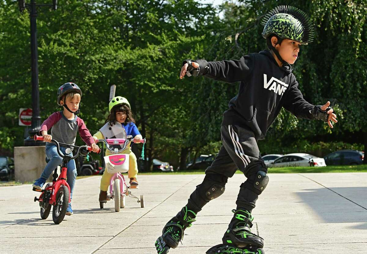 Cyrus D'Cruz, 8, of Albany rollerblades around the Soldiers and Sailors?• Monument followed by his friend Pietro Forni, 6, of Albany, left, and his sister Sara Simone D'Cruz in Washington Park on Monday, Sept. 21, 2020 in Albany, N.Y. (Lori Van Buren/Times Union)