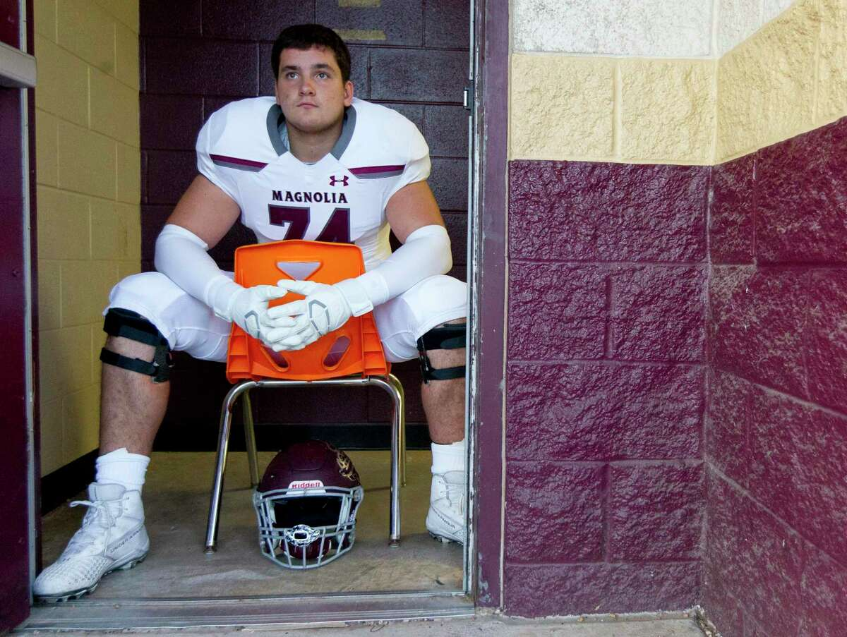 Magnolia offensive lineman Matthew Wykoff (74) watched Magnolia West warm up before a District 8-5A high school football game at Magnolia West High School, Friday, Nov. 1, 2019, in Magnolia.