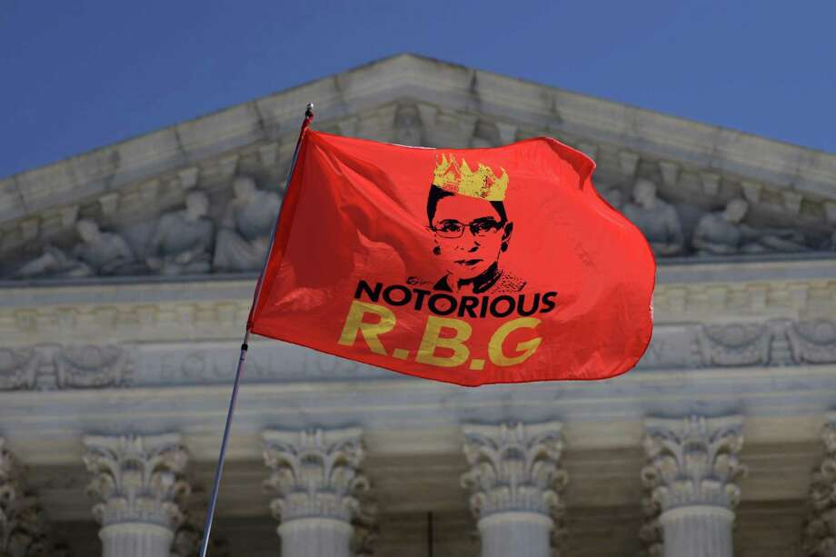 An RBG flag is flown in front of the U.S. Supreme Court for the late Justice Ruth Bader Ginsburg Sept. 21 in Washington, D.C. Justice Ginsburg died last Friday from complications of pancreatic cancer at the age of 87. Photo: Alex Wong / Getty Images / 2020 Getty Images