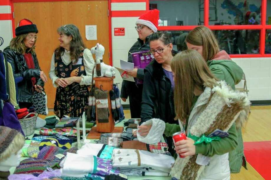 Shoppers look over different craft goods at the Holly Berry Fair last year. This year's iteration of the fair has been canceled due to coronavirus concerns. (Tribune File Photo)