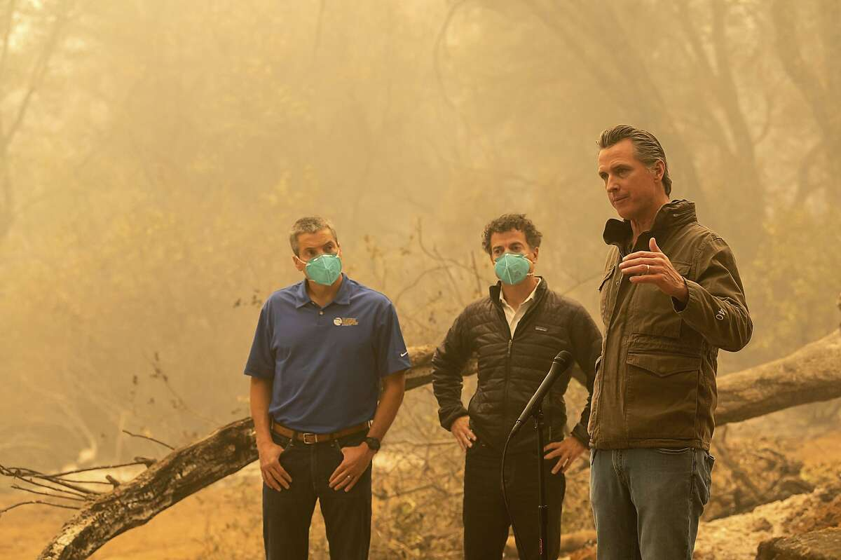"""California Gov. Gavin Newsom, right, tours the North Complex Fire zone with California Secretary for Natural Resources Wade Crowfoot, left, and California Secretary for Environmental Protection Jared Blumenfeld in Butte County. Newsomstrongly asserted to the media that climate change was evident and pledged to redouble efforts to """"decarbonize"""" the economy."""
