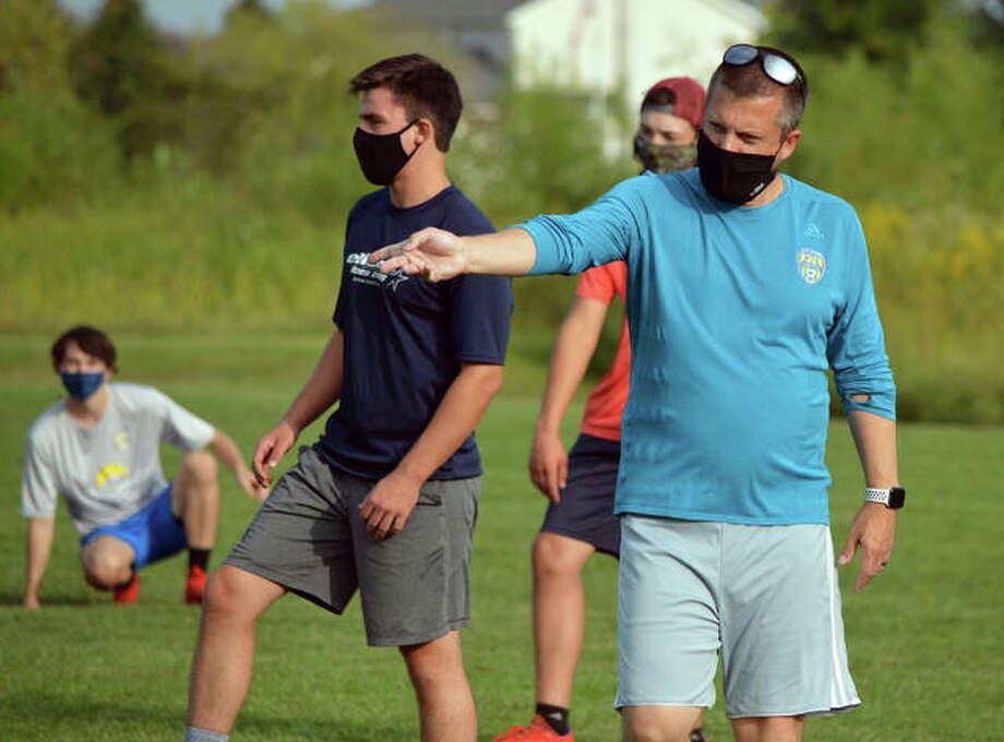 Father McGivney boys soccer coach Matt McVicar gives instructions to his players during practice last week.