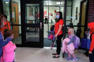 Caseville students are lead inside on the first day of school. Superintendent Ken Ewald said there has been no coronavirus-related incidents so far in the first two weeks of school. (Tribune File Photo)