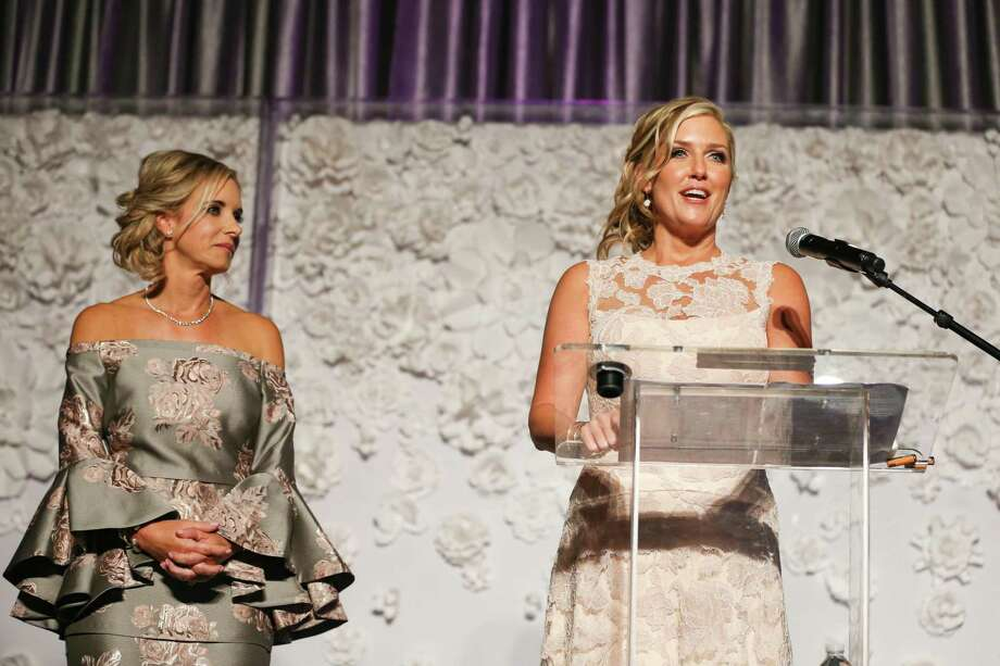 Like many other events in 2020, the annual Memorial Hermann In the Pink of Health gala has been canceled and replaced with what organizers described as an enhanced virtual event. The gala is a major fund-raiser for breast cancer awareness and research and normally sees hundreds of attendees don elaborate garb and outfits while raising money over a luncheon. In this 2017 photo, hosts Cheryl Brady, left, and Tiffany McClung, right, co-chairs for the In the Pink of Health committee, speak during the 2017 luncheon. Photo: Michael Minasi, Staff Photographer / Houston Chronicle / © 2017 Houston Chronicle