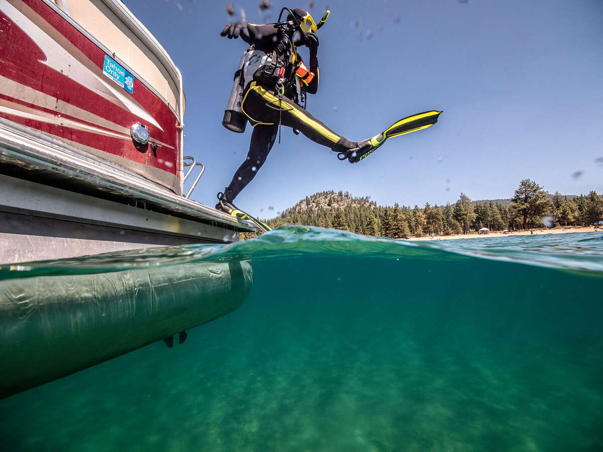 Scuba divers pick up trash in Lake Tahoe near Nevada Beach on Thursday, August 27, 2020.