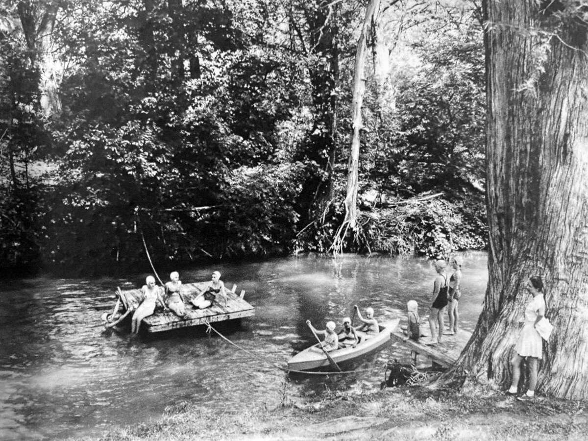 In an undated photo, young women enjoy a common way to beat the summer heat in pre-air-conditioned San Antonio, by going to swimming holes along the area's many streams and rivers.