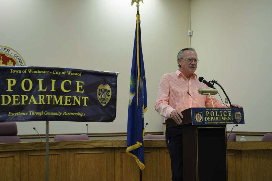 Town Manager Robert Geiger gives remarks during an event honoring local police officers in 2018. Photo: Leslie Hutchison / Hearst Connecticut Media /