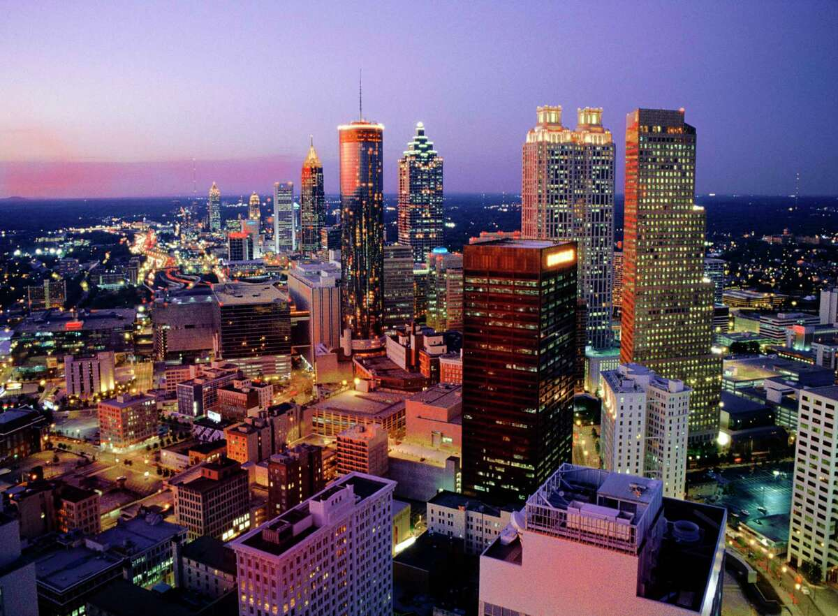 Midtown Atlanta skyline viewed form Marietta St. in downtown Atlanta at dusk. credit: Kevin C. Rose