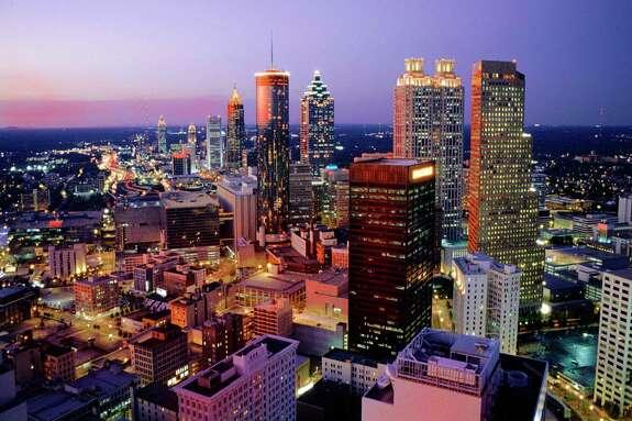 Midtown Atlanta skyline viewed form Marietta St. in downtown Atlanta at dusk. credit: Kevin C. Rose