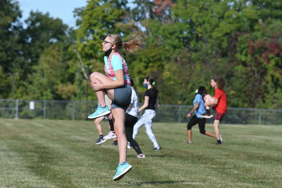 Rensselaer High School cross country team members go through warmup exercises during practice on Monday, Sept. 21, 2020, at Rensselaer High School in Rensselaer, N.Y. The school received a $10,000 donation from Stewart's Shops to help pay for its sports programs. Rensselaer is relying on donations to field teams this school year. (Will Waldron/Times Union)