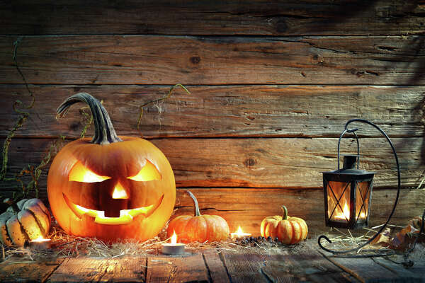 Jack O' Lantern On Wooden Table With Lantern