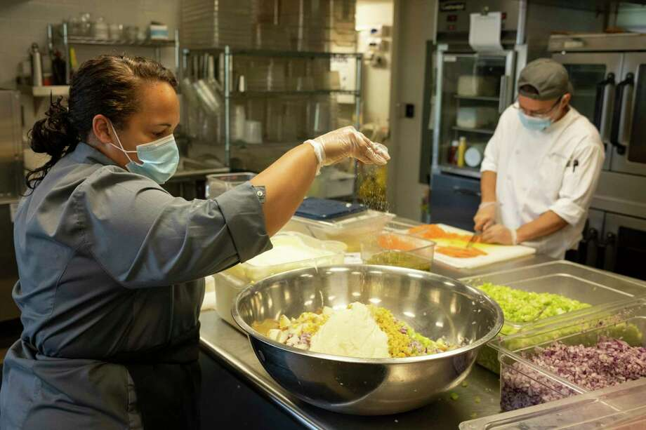 Chef Neena Perez, Luis Caravantes and Grace Farms' Commons Team prepare healthy, nutritious meals to help alleviate food insecurity in Fairfield County. Photo: Contributed / Grace Farms Foundation
