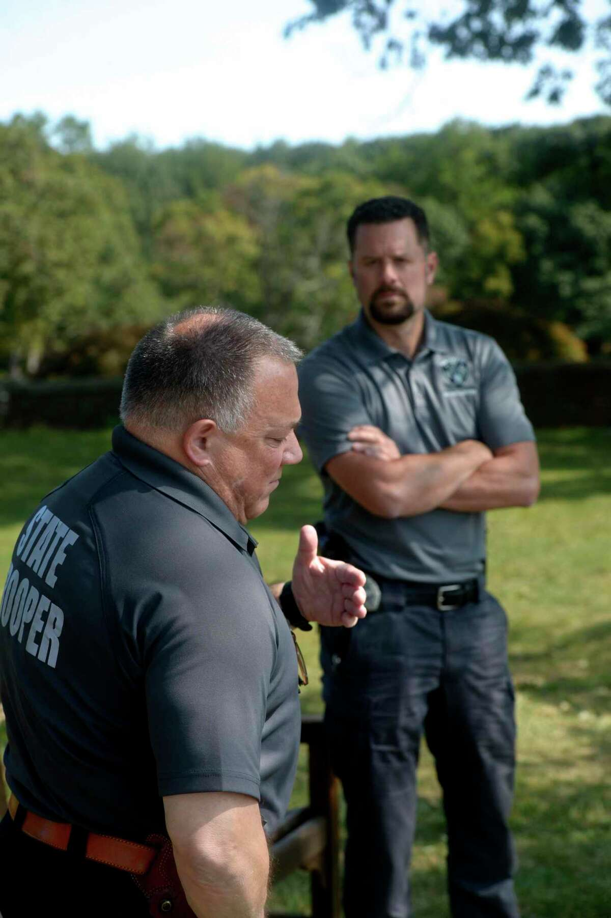 Detective John Kimball, left, Connecticut State Police Western District Major Crime, and Officer Thomas Patten, New Canaan Police Department, who is assigned to the investigation devision, sit in Waveny Park and talk about the Dulos investigation Monday in New Canaan.