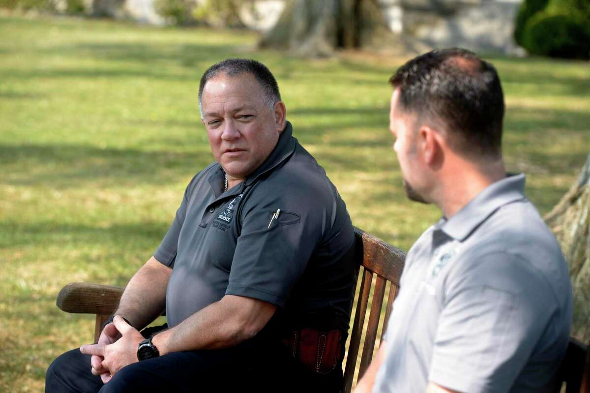 """Detective John Kimball, left, Connecticut State Police Western District Major Crime, and Officer Thomas Patten, right, New Canaan Police Department, who is assigned to the investigation devision, sit in Waveny Park and talk about the Dulos investigation. Monday in New Canaan. Eureka moments? The investigators offered details about finding certain pieces of key evidence in the case. Like when a public call from police for doorbell camera footage led to the discovery of surveillance images of a man who looked like Fotis Dulos riding what appeared to be a vintage French bicycle he owned in the direction of Jennifer's house the morning of her disappearance, Kimball said. Kimball recalled another state police detective discovering the footage while looking through evidence at the Troop G barracks in Bridgeport. """"He literally jumped up and said, 'John, come here, I want to show you something,'"""" Kimball said. And when a New Canaan police officer examining footage from school bus security videos spotted Gumienny's pickup truck parked the morning of the disappearance near where Jennifer Dulos' abandoned Chevy Suburban was found that night, """"The hair on the back of my neck just went up,"""" Kimball said. """"Finding a piece of information like that is highly significant."""""""