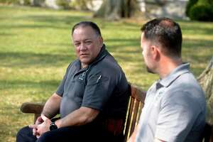 Detective John Kimball, left, Connecticut State Police Western District Major Crime, and Officer Thomas Patten, right, New Canaan Police Department, who is assigned to the investigation devision, sit in Waveny Park and talk about the Dulos investigation. Monday in New Canaan.