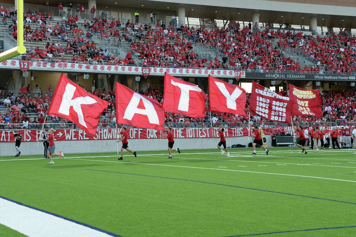 The Katy Spirit squad runs flags following a touchdown during the second quarter of a non-district football game between the Katy Tigers and the Clear Springs Chargers on Saturday, September 21, 2019 at Legacy Stadium, Katy, TX.