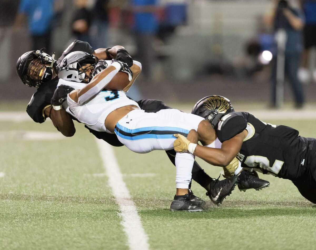 Kelvon Brown (3) of the Shadow Creek Sharks is stoped for a 4 yard loss by Udoka Ezeani (52) and Zachary Hopper (23) of the Foster Falcons in the first half in a high school football game on Thursday, October 24, 2019 at Traylor Stadium in Rosenberg Texas.