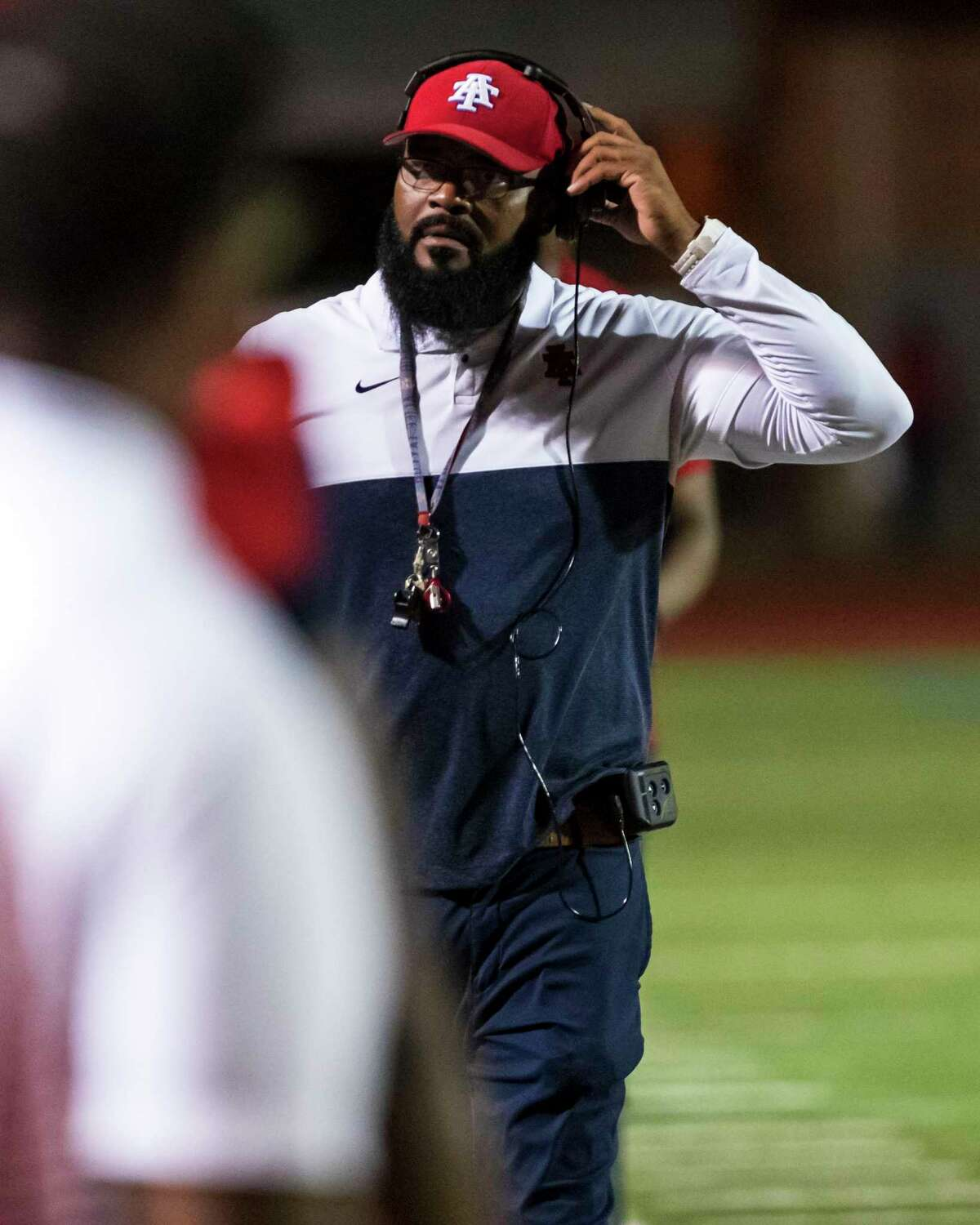 Alief Taylor head coach Brian Randle is shown on the sidelines in the second half of a high school football game Thursday, Oct 10, 2019, in Houston.