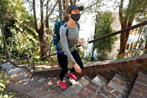 Alexandra Kenin climbs the Greenwich Street steps in Telegraph Hill neighborhood of San Francisco, Calif., on Wednesday, August 12, 2020. Kenin has climbed all 900 outdoor staircases in San Francisco and logged them online.