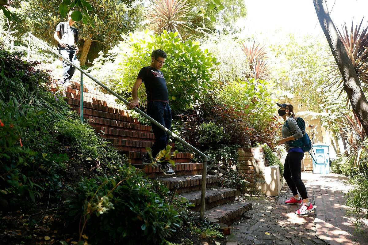Alexandra Kenin waits for two people to pass while climbing the Greenwich Street steps in Telegraph Hill neighborhood of San Francisco, Calif., on Wednesday, August 12, 2020. Kenin has climbed all 900 outdoor staircases in San Francisco and logged them online.