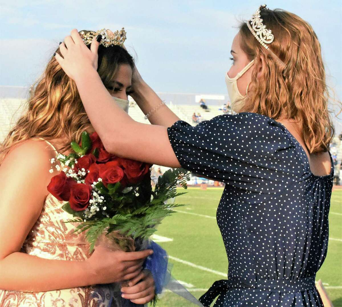 Needville High School senior Amanda Nowak, left, is crowned 2020 Homecoming Queen by 2019 Homecoming Queen Ashton Schiller prior to the start of the football game on Friday, Sept. 18.