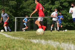 Maple Hill varsity soccer players run drills during practice behind the Maple Hill Middle School on Monday, Sept. 21, 2020 in Schodack, N.Y. (Lori Van Buren/Times Union)