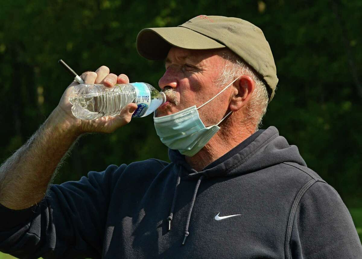 Maple Hill Coach Dan Gillespie takes down his face mask to get a drink of water during boy's soccer practice at Maple Hill Middle School on Monday, Sept. 21, 2020 in Schodack, N.Y. (Lori Van Buren/Times Union)