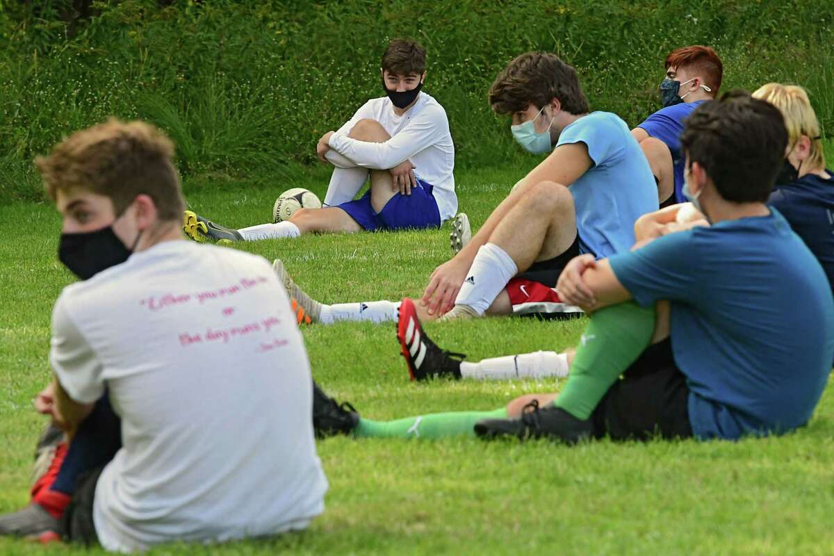 Maple Hill varsity soccer players stretch during practice behind the Maple Hill Middle School on Monday, Sept. 21, 2020 in Schodack, N.Y. (Lori Van Buren/Times Union)