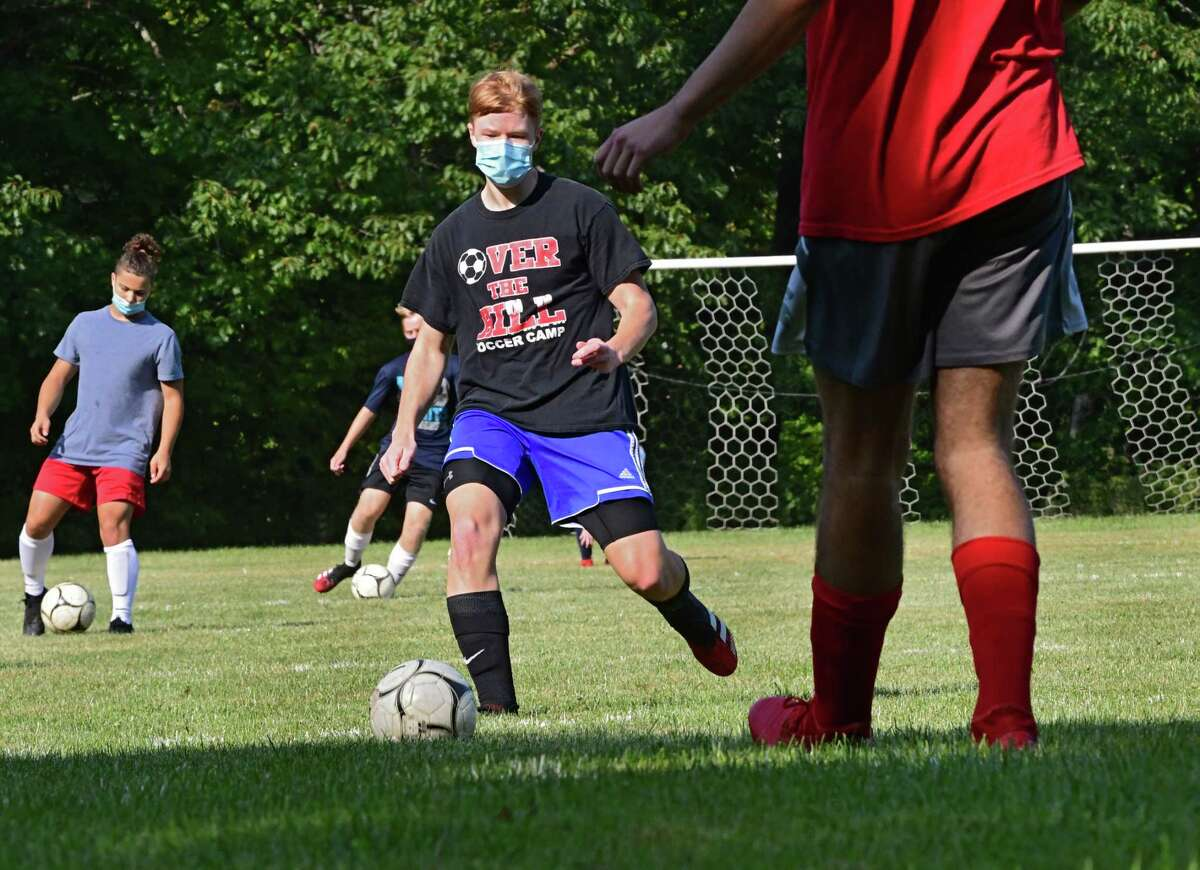 Dominic Hirschoff, right, kicks the ball to Aiden Fletcher, second from right, during boy's soccer practice at Maple Hill Middle School on Monday, Sept. 21, 2020 in Schodack, N.Y. (Lori Van Buren/Times Union)
