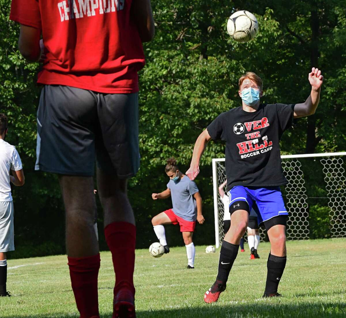 Dominic Hirschoff, left, throws the ball to Aiden Fletcher, right, who heads it during boy's soccer practice at Maple Hill Middle School on Monday, Sept. 21, 2020 in Schodack, N.Y. (Lori Van Buren/Times Union)
