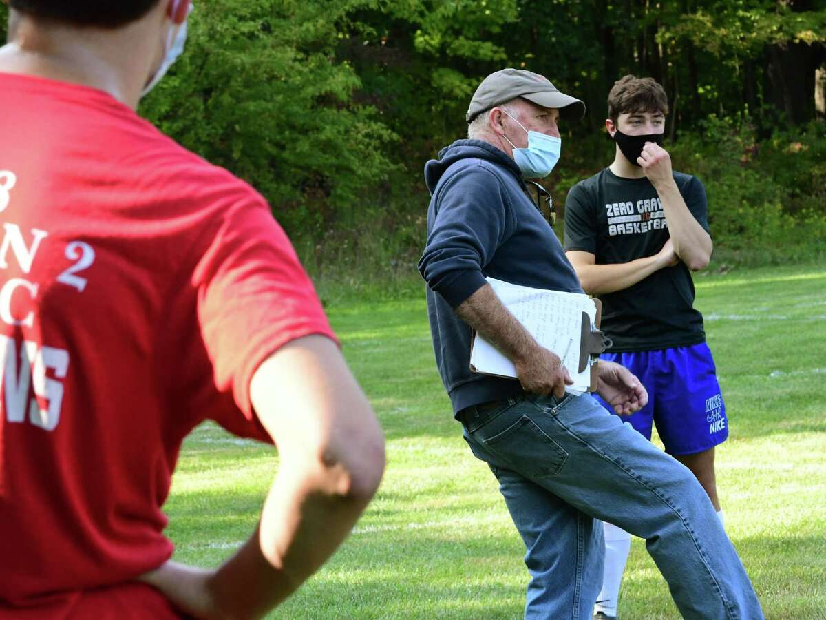 Maple Hill Coach Dan Gillespie, center, talks to his players during boy's soccer practice at Maple Hill Middle School on Monday, Sept. 21, 2020 in Schodack, N.Y. (Lori Van Buren/Times Union)