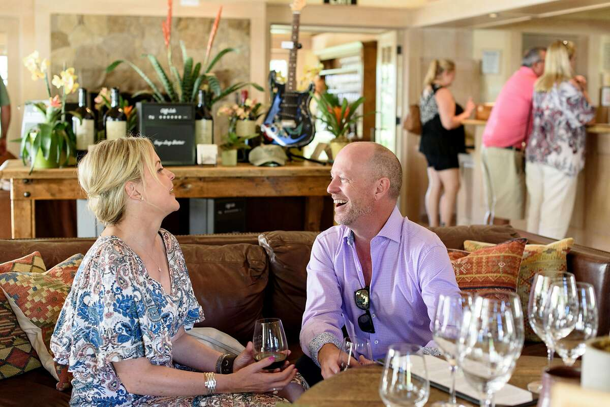 Haylie DiGiusto and Lance Matton taste wine in the tasting room at Cliff Lede Winery in Yountville, Calif., on Saturday July 7, 2018.