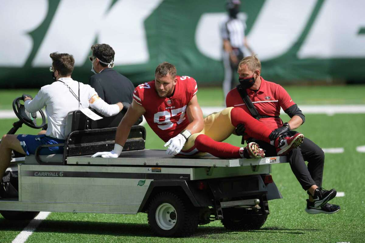 San Francisco 49ers defensive end Nick Bosa (97) is carted off the field after being injured during the first half of an NFL football game against the New York Jets, Sunday, Sept. 20, 2020, in East Rutherford, N.J. (AP Photo/Bill Kostroun)